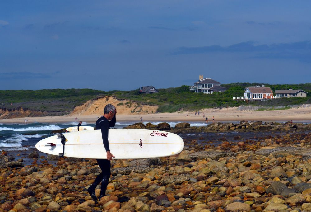 Surfer in Ditch Plains Beach