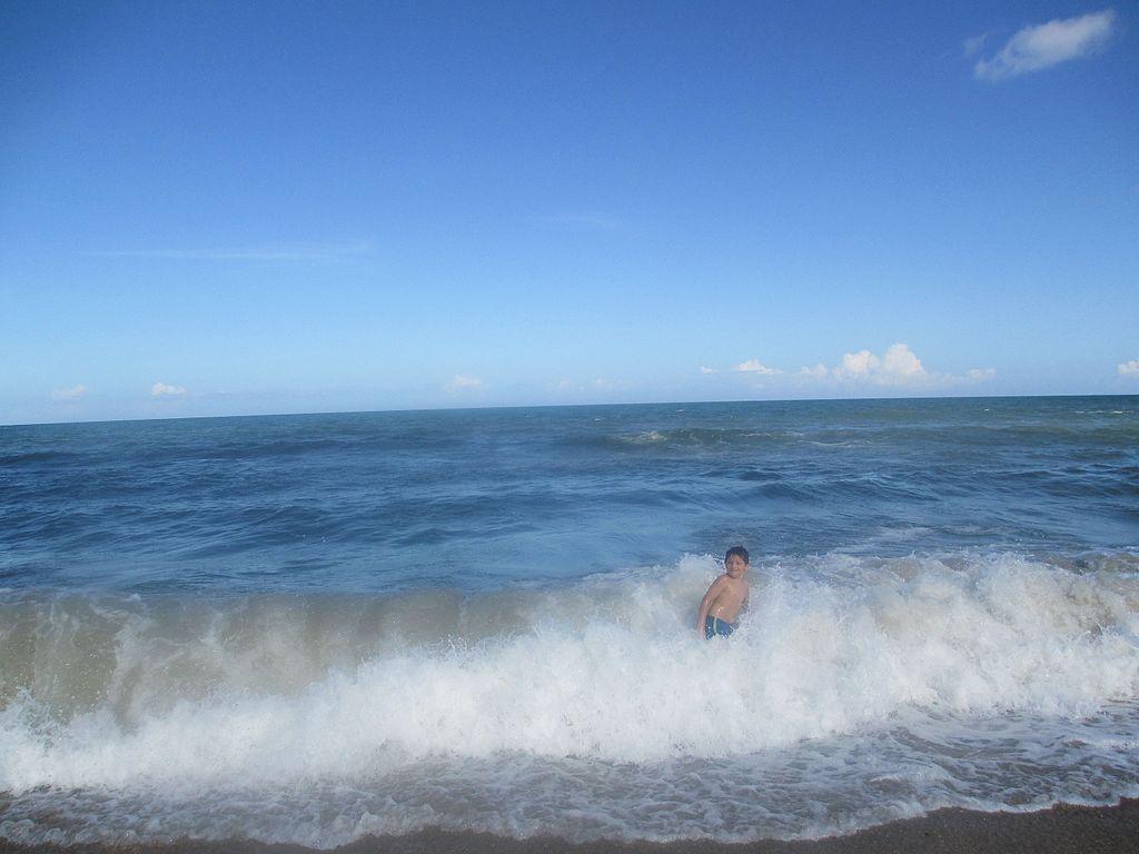 A kid surfing in Carolina Beach