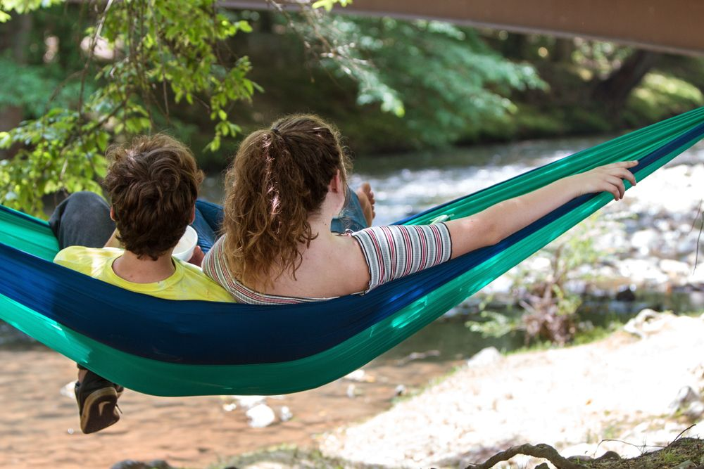 A couple relaxing in Meeks Park