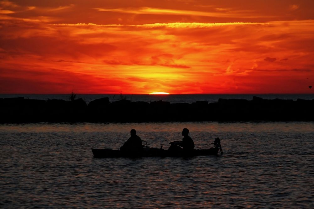 People in Canoe watching sunset