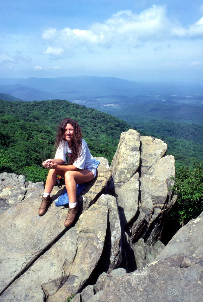 Woman sitting on Humpback Rocks