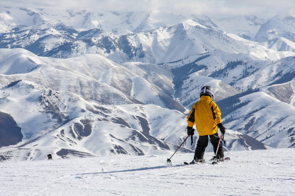 A kid skiing in the snowy Mountains of Sun Valley