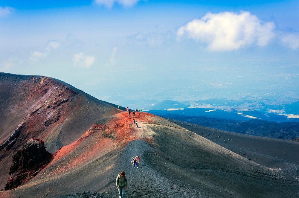 People hiking to Mount Etna Volcano