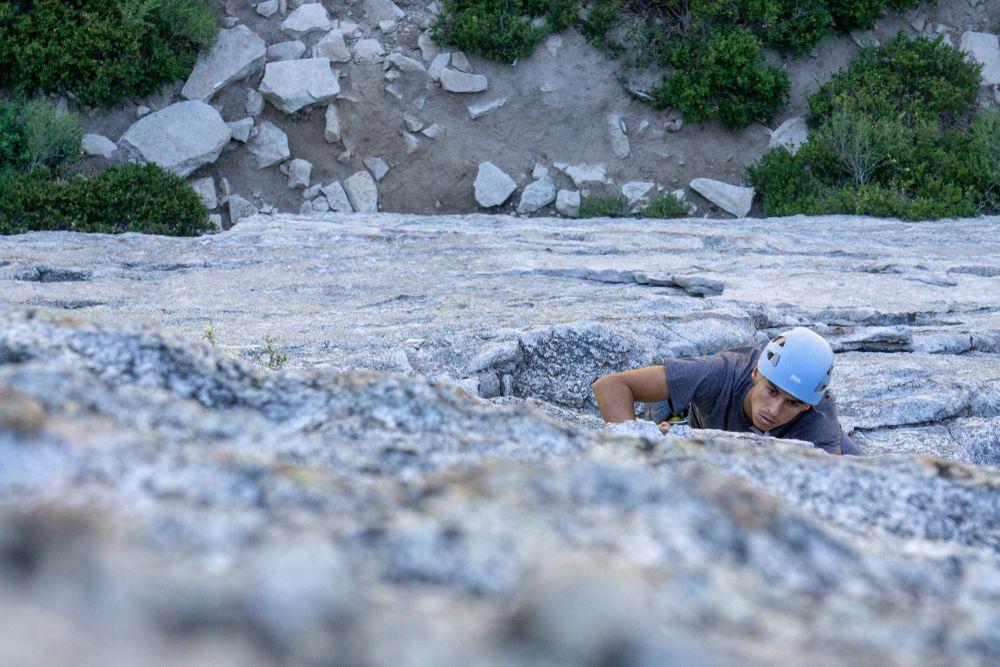 A man climbing on a rock in Lake Tahoe