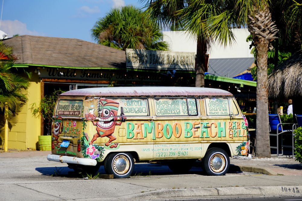 A Van in front of Bamboo Beach Bar and Grill