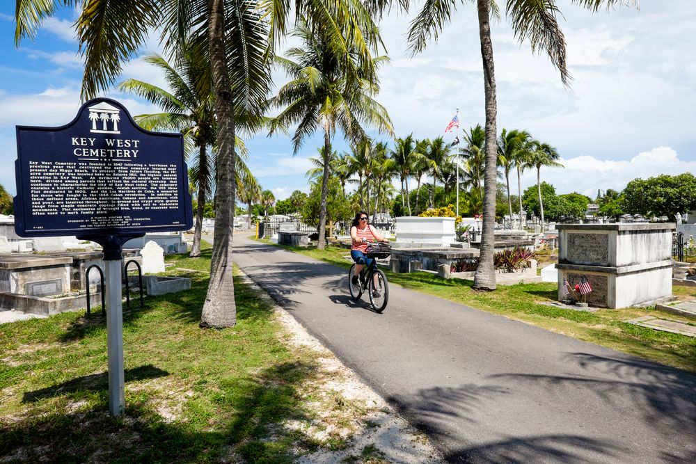 A Woman in Bicycle in Key West Cemetery