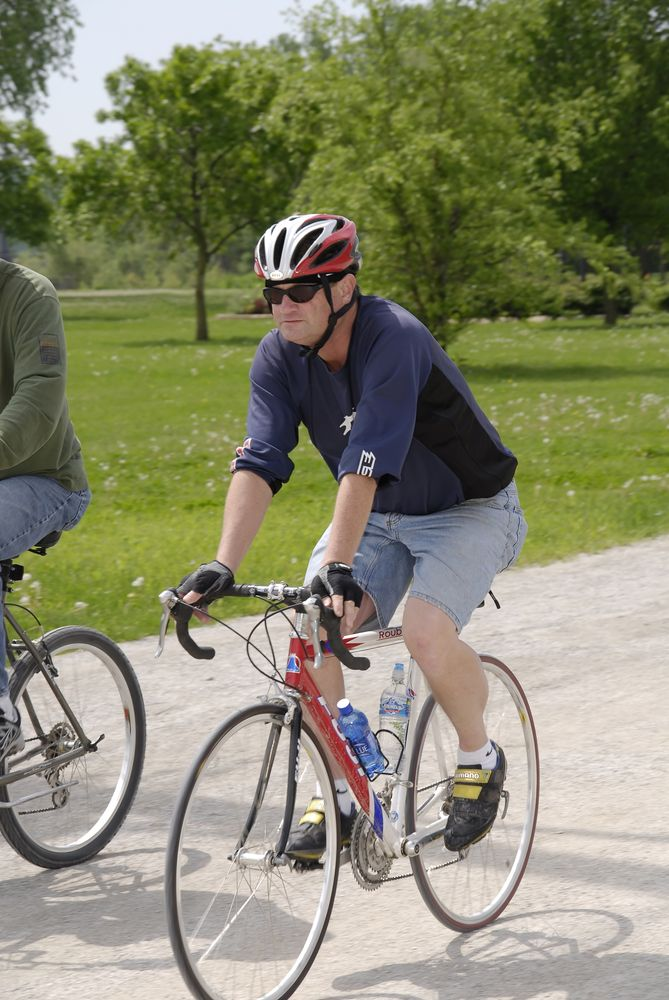 A man riding a bicycle in Katy Trail Park